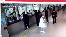 Kind-hearted Chinese man sprints away after throwing a bag of cash worth £12,000 onto hospital counter