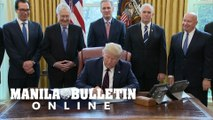 Trump signs $2 trillion rescue plan for virus-hit US economy