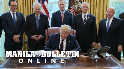 Trump signs $2 trillion rescue plan for virus-hit US economy
