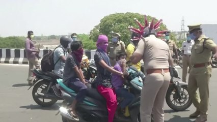"""Stopping traffic: the """"coronahelmet"""" helping Indian police"""