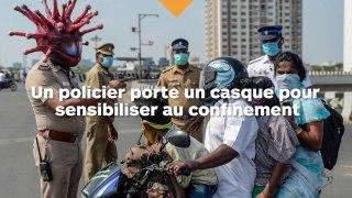 Un policier porte un casque en forme de coronavirus pour sensibiliser au confinement