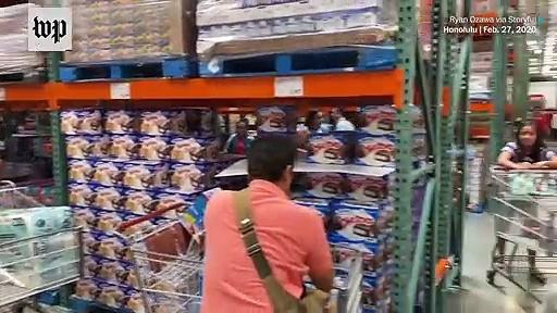 Breaking News Amid coronavirus panic, customers pack stores for household essenti