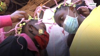 'Corona-style' hairdo helps raise awareness of disease in Kenya