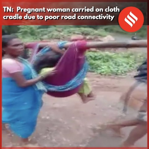 Pregnant woman carried on cloth cradle due to poor road connectivity