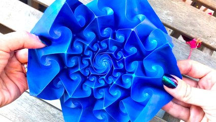 Artist makes kinetic origami that shrinks and expands