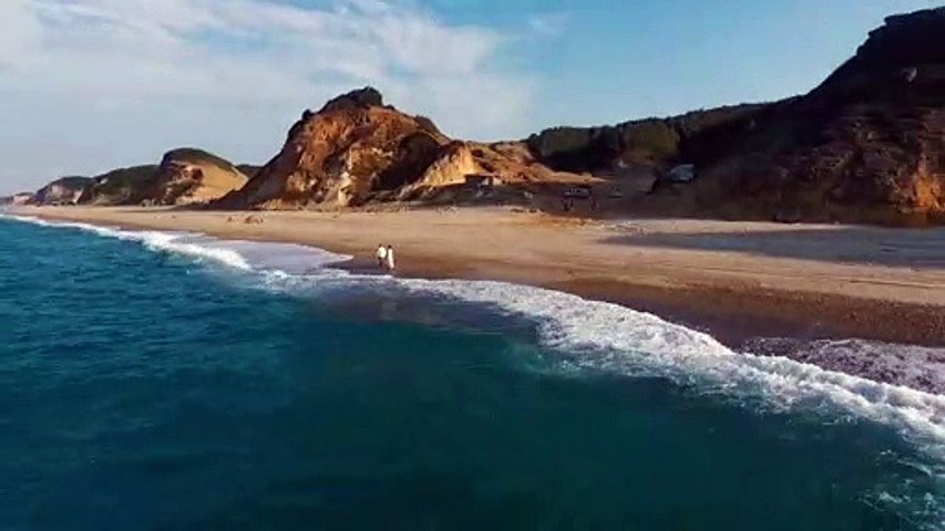 Drone view - couple on beach shore