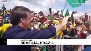Supporters greet Bolsonaro amid controversy over cabinet video