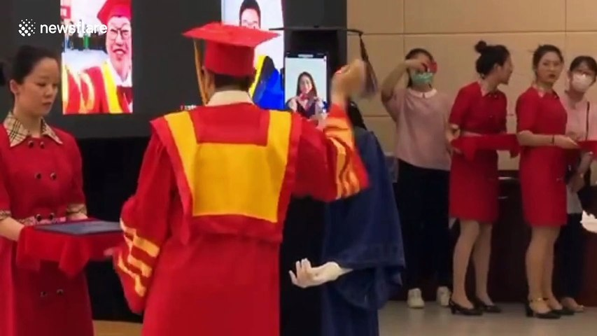 Chinese university uses robots to replace students for graduation ceremony amid coronavirus pandemic