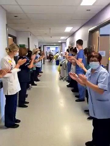 Nurse Becky Usher is applauded as she leaves Pinderfields Hospital