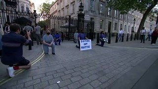 Doctors protest during 'Clap for Carers' on Whitehall