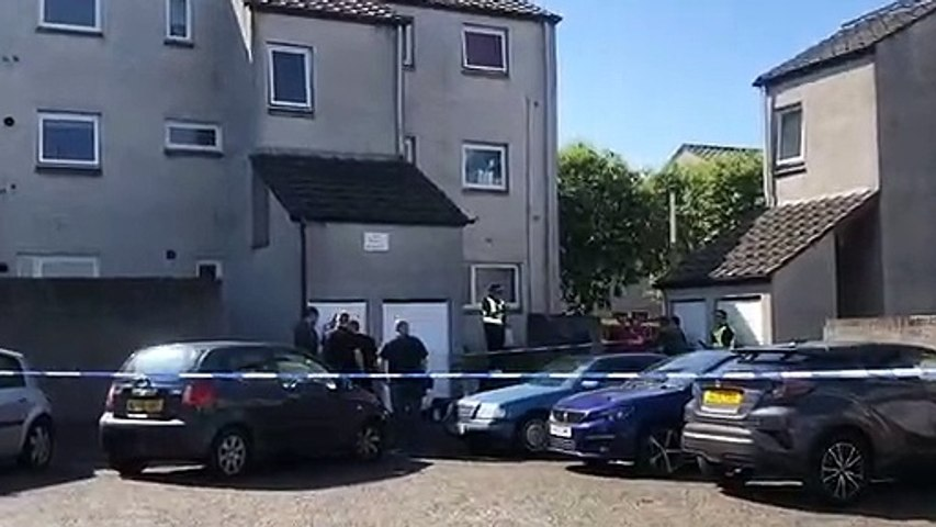 Police on the scene where a man has died following an incident in the west of Edinburgh