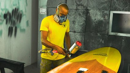 How handcrafted wooden paddle boards are made from recycled materials