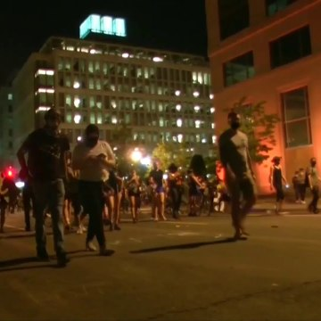 Protests against police violence continue after dark in Washington, D.C.