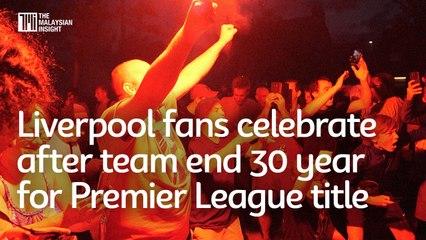 Liverpool fans celebrate after team end 30 year for Premier League title