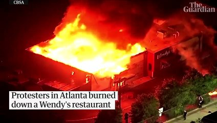 Rayshard Brooks: protesters set fire to Wendy's after black man shot dead by police – video report