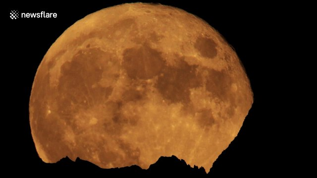 July's 'buck moon' rises over Dent Blanche mountain in Swiss Alps