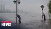 Heavy rain raises flood alert levels for cities on Yangtze River
