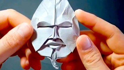 This artist folds intricate origami faces with paper