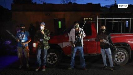 Armed civilians patrol streets to enforce COVID-19 measures in Guatemala