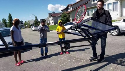 Community Surprises Hardworking Kids With Basketball Hoop