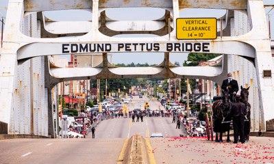 Body of John Lewis makes final Selma bridge crossing – video