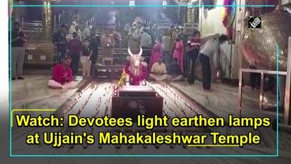 Devotees light earthen lamps at Ujjain's Mahakaleshwar Temple
