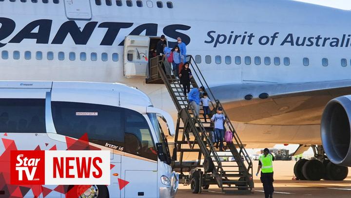 Coronavirus: Australians from Wuhan arrive at quarantine