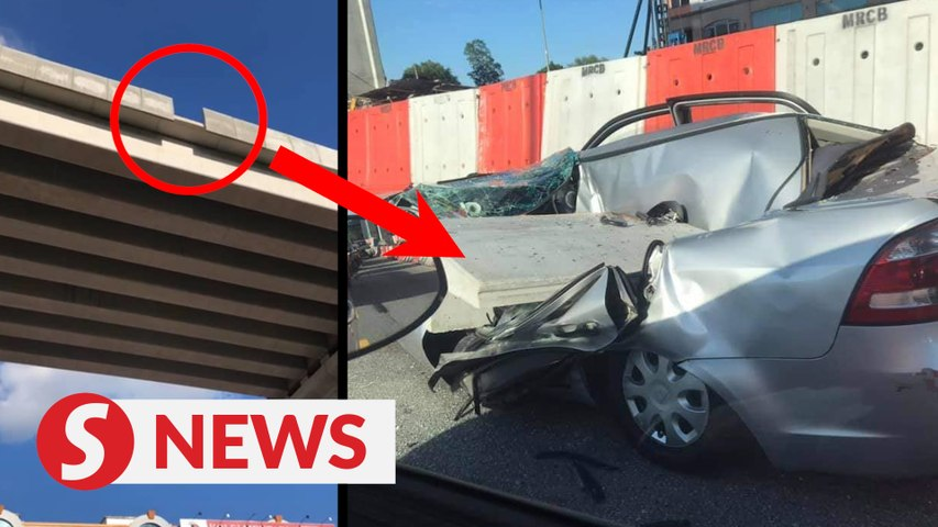 Woman's lucky escape after large piece of concrete falls on her car