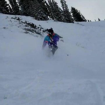 Skier Tumbles Down Snowy Mountain