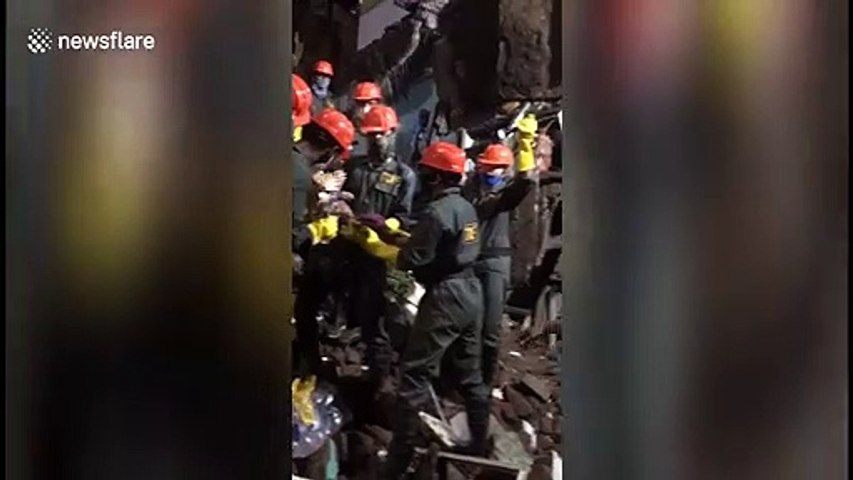 Moment child rescued from underneath debris of collapsed building in western India