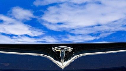 Tesla Slides 7%, Investors Wait