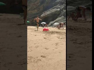 Guy Fails While Flipping off Ball at Beach