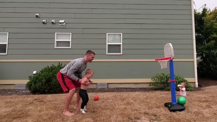 Toddler Makes Mini Basketball Trickshots With Dad