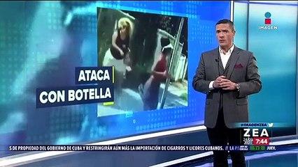 Mujer ataca con una botella a corredora afroamericana