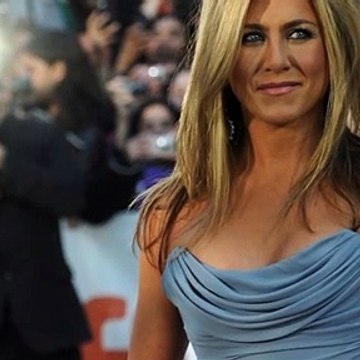 Jennifer Aniston wore a diamond ring on her engagement finger after holiday with director Will Speck