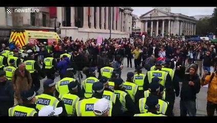 Scores of police move into Trafalgar Square to break up anti-lockdown protest