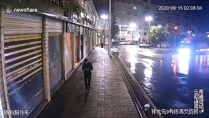 Chinese pedestrian narrowly avoids being hit by truck smashing into shop