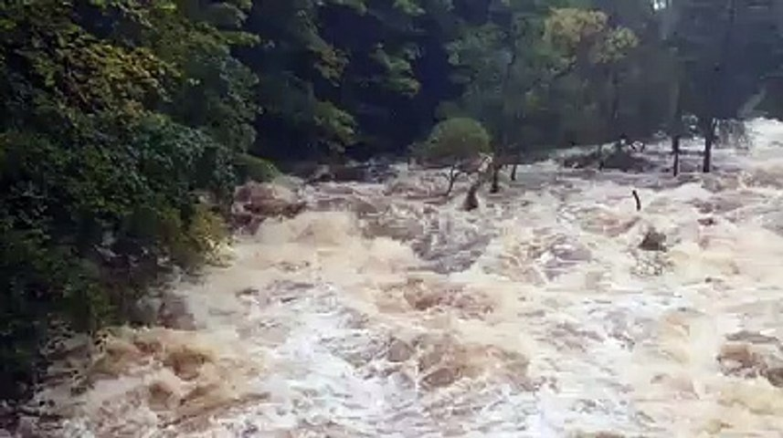 Dramatic video shows raging river following heavy rainfall