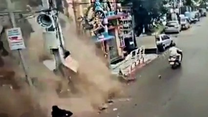 Walls collapses, misses pedestrian by inches
