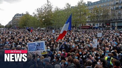Thousands gather in Paris in memory of murdered teacher