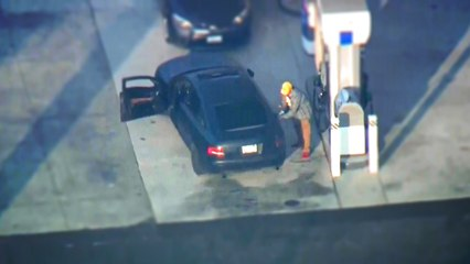 Suspect stops for gas during police pursuit