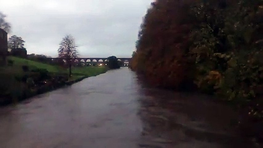 River Calder running high in Whalley, Ribble Valley, Lancashire