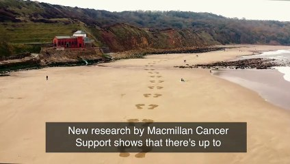 Giant footprints on the sand at Cayton Bay