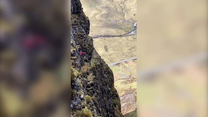 This stunning video shows two daredevils base jumping off the narrowest ridge in the UK in a 'heart in mouth' moment