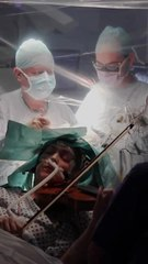 A Musician Plays The Violin During Brain Surgery