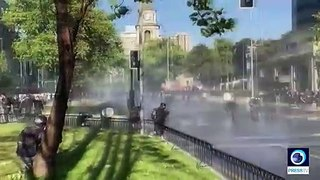 Riot police and water cannon in force as protesters march in Chile