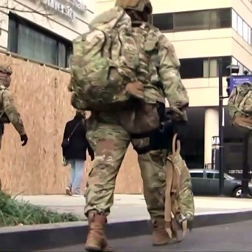 Dozen troops removed amid inauguration vetting