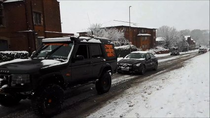 Cars rescued from snow in Northampton Road, Kettering