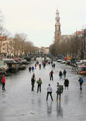 Skaters glide across frozen surfaces of Amsterdam canals