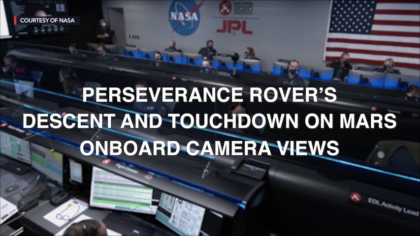 Mars rover sends home movie of daredevil descent to landing on red planet